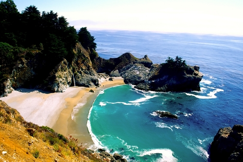 Big Sur is a sparsely populated region of the central California, United States coast where the Santa Lucia Mountains rise abruptly from the Pacific Ocean. The terrain offers stunning views, making Big Sur a popular tourist destination.