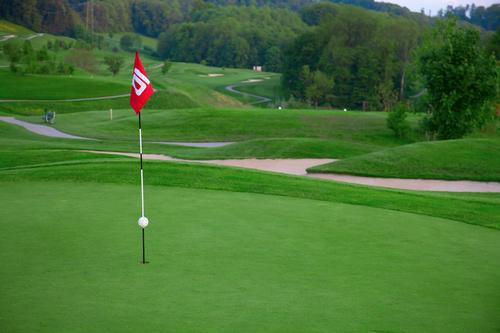 Golf flag on the green grass